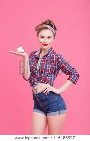Attractive young woman is presenting sweet food