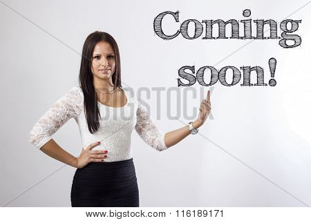 Coming Soon! - Beautiful Businesswoman Pointing