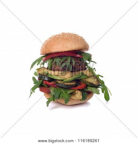 Veggie chickpea falafel burger with arugula, zucchini, avocado and mustard. Isolated on white.
