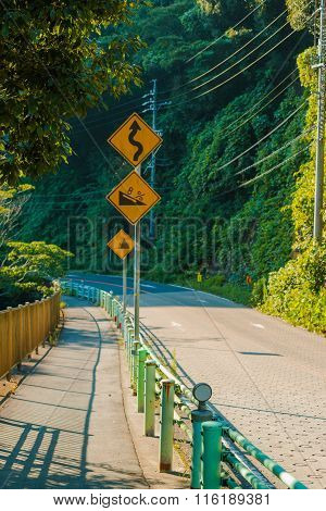 Signs On Curves And Slopes Road On Mountain.