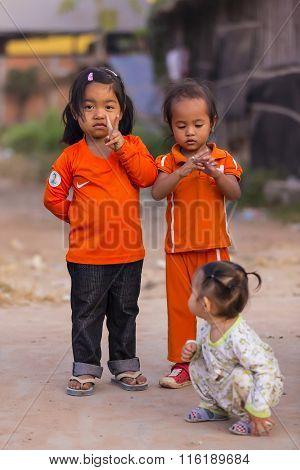 Cambodian Girls In Muslim District Of The Town Show Their Fingers
