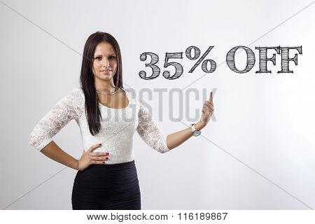 35 Percent Off - Beautiful Businesswoman Pointing