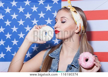 Attractive young American woman with sweet food