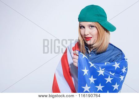 Cheerful American girl is expressing positive emotions