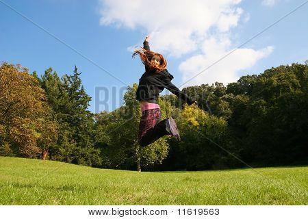 Girl jump on the meadow