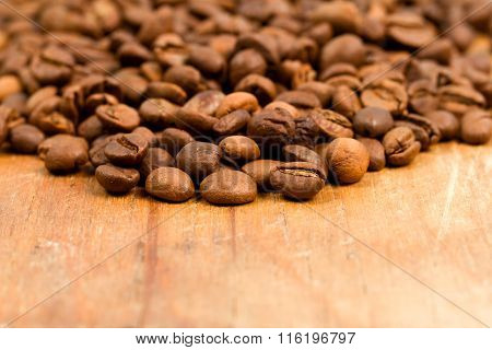 Coffee Beans On Wood Background.