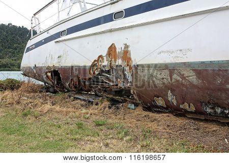 Damaged Catamaran On Land
