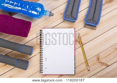 Sport Equipment. Dumbbells, Drink, Notebook.