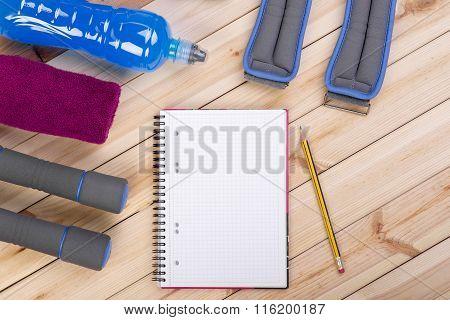 Sport Equipment. Dumbbells, Drink, Notebook.