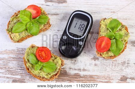 Glucometer And Freshly Sandwiches With Paste Of Avocado, Diabetes, Healthy Food And Nutrition