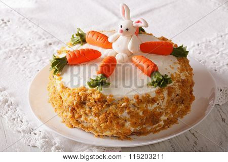 Carrot Cake With Candy Bunny Close-up On The Table. Horizontal
