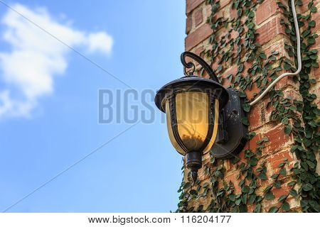 Ancient Lantern On Wall With Blue Sky
