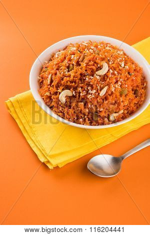 tasty gajar halwa or gajar ka halwa made up or fresh carrot, sugar and milk. decorated with almond o