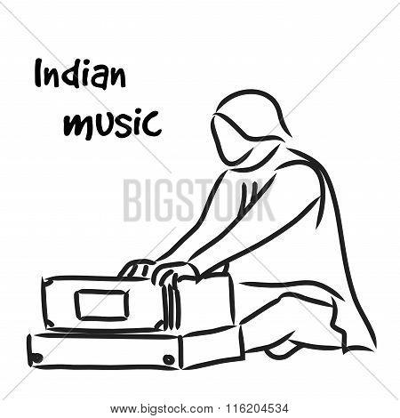 Indian musician playing harmonium