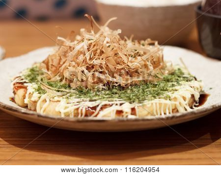 Japanese traditional food. Okonomiyaki or Japanese pizza in japanese restaurant.