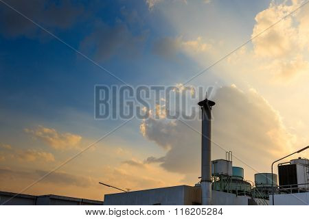 Smokestack On Factory With Sunset Sky