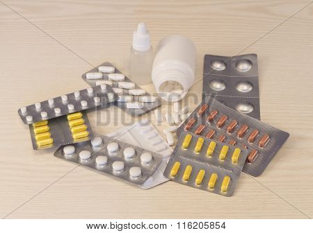 Many Various Pills Lying On The Table