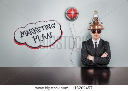 Marketing plan text with alert light and vintage businessman
