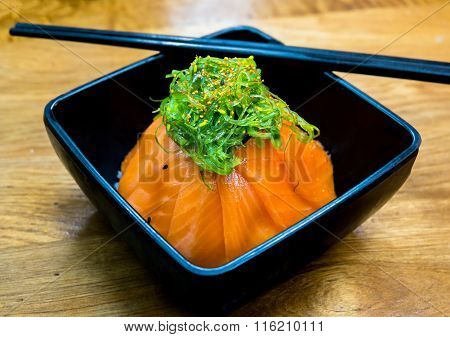 Cup Of Salmon Sushi And Green Seaweed On The Top