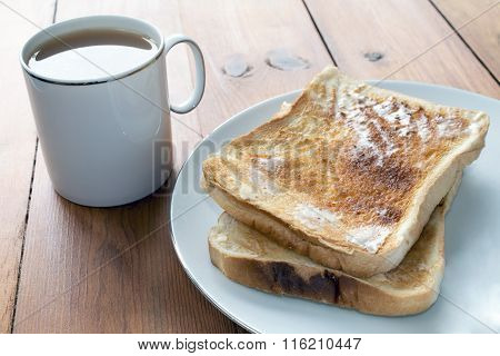 Tea And Toast On Wooden Table