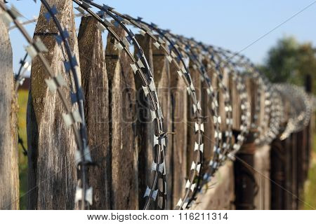 Old Wooden Fence With Barbed Wire Perspective