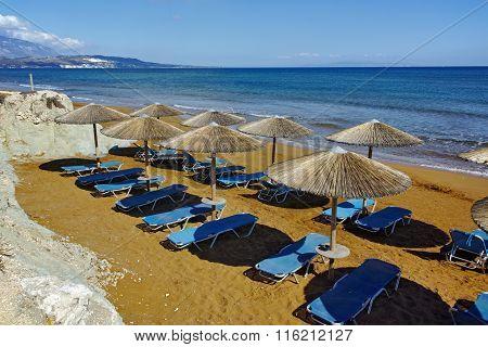 Thatched umbrellas on the xsi beach, Kefalonia,  Greece