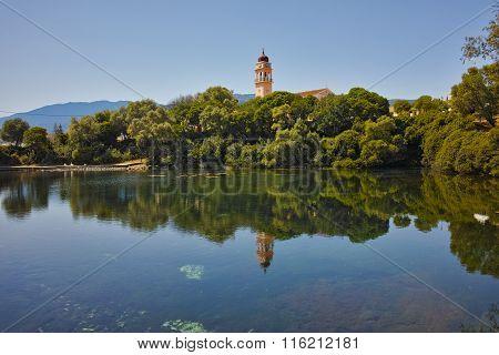 Reflection of church in karavomilos lake, Kefalonia, Ionian islands, Greece