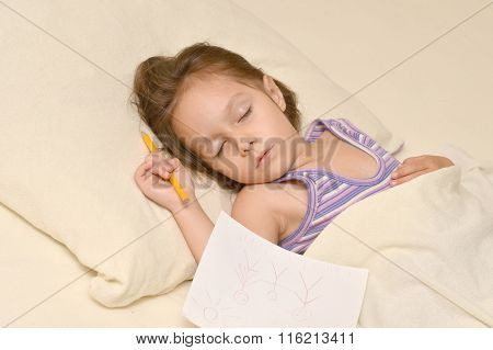 Little girl sleeping with picture