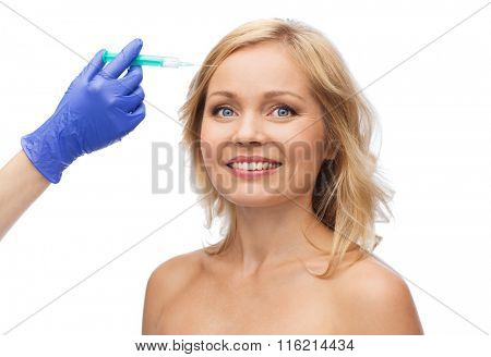 happy woman face and beautician hand with syringe
