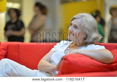 Mature woman sitting in  sofa