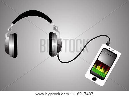 Headphones and mobile phone with playing music on the silver background closeup