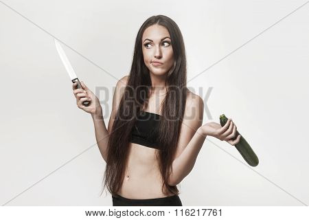 Funny Image Of Young Woman Holding Zucchini And Knife