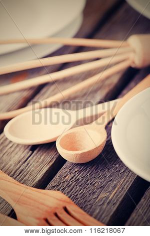 Vintage Photo Of Wooden Cutlery On Old Table