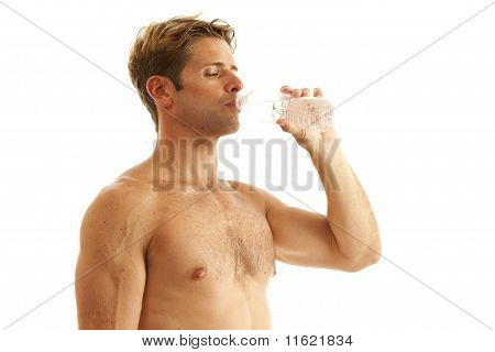 Young man drinking bottle of water