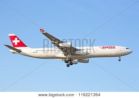 ZURICH - JULY 18: Swiss A-340 landing in Zurich airport on July 18, 2015 in Zurich, Switzerland. Zurich airport is home port for Swiss Air and one of the biggest european hubs.