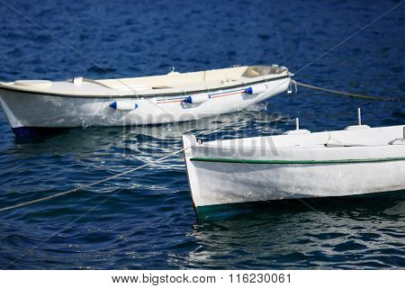 Small Fishing Boat On The Sea Water In A Sea Bay