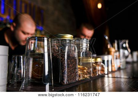 Two Bartenders Quickly Working