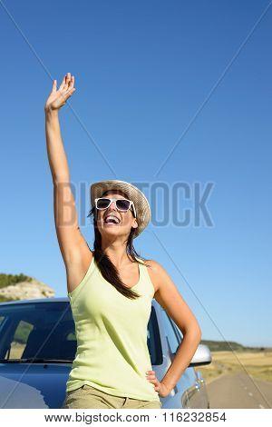 Woman On Car Roadtrip Waving