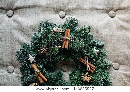 Christmas wreath with decoration  cinnamon on grey