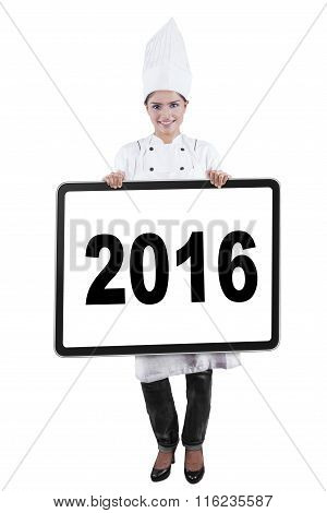 Young Chef Showing Number 2016 On Board