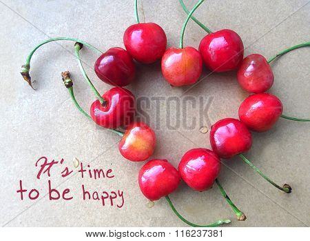 Red Cherry In Shape Of Heart With Stem Isolated On Grey With Text It's Time To Be Happy.