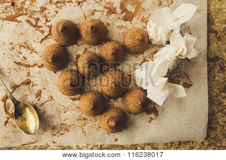 Homemade Chocolate Truffles On Cooking Paper Top View