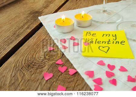 Yellow Sticky Note For Saint Valentine's Day And Little Pink Paper Hearts