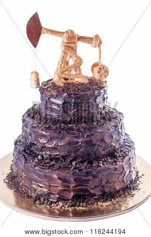 Black handmade cake with oil derrick on a substrate
