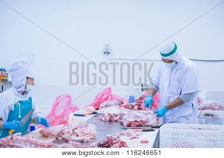 Cutting Meat Slaughterhouse Workers In The Factory