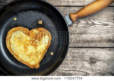Fried Pancakes - Heart On A Cast Iron Skillet . Top View .