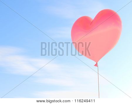 Heart shaped red balloon with blue sky background.