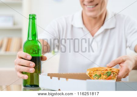 Adult man eating pizza