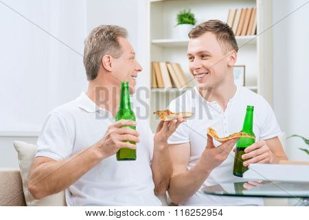 Father and his adult son drinking beer