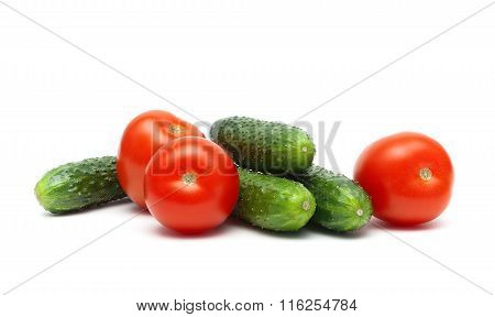 Cucumbers And Tomatoes Isolated On White Background